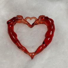 Picture of print of Man & women heart pendant