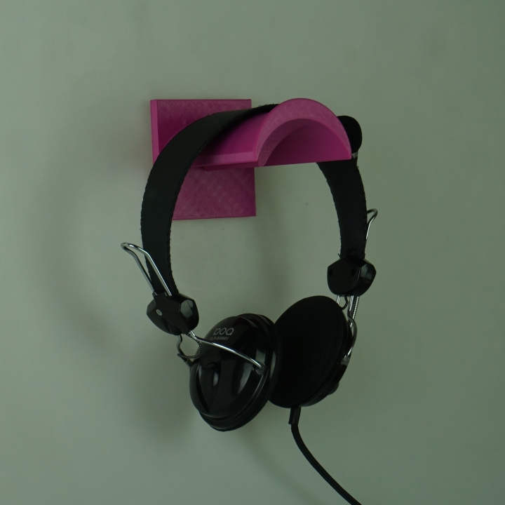 Wall mounted headphone stand with hidden screws.