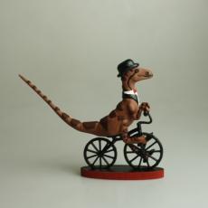 Gentleman Raptor Riding a Bike