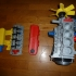 Complete working model, 4 cylinder engine, transmission, and transfer case. Educational Toy print image