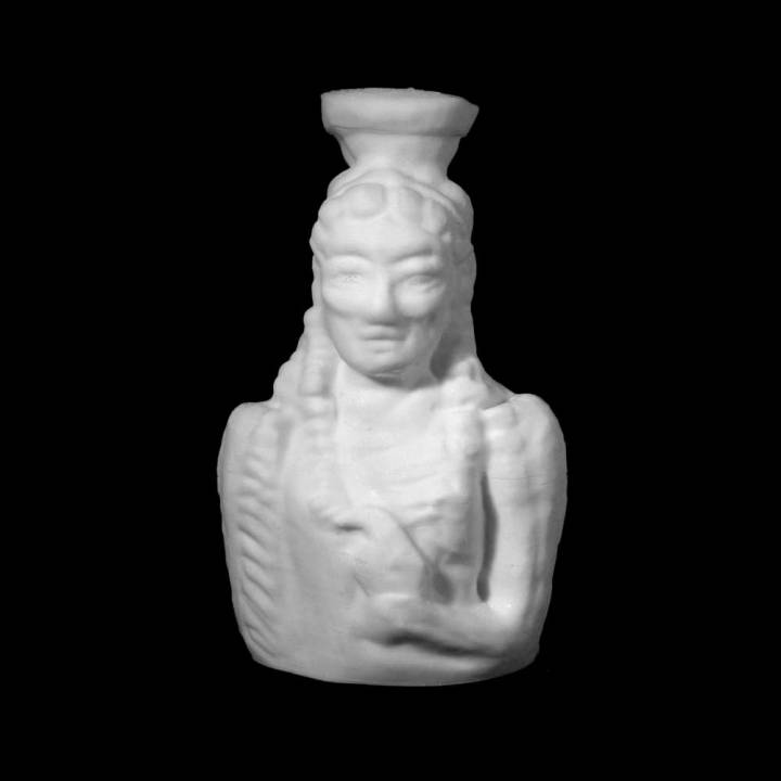 Vessel in the form of a female holding a bird at The British Museum, London