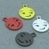 Smirking Emoji Keychain Charm image