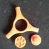 a twist on the original fidget spinner idea. image