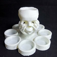 Skull in hand candle holder