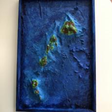Picture of print of Hawaiian Islands with seafloor