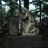 Gravestone Depicting Woman Praying image