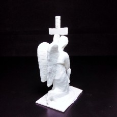 Gravestone Depicting Angel Holding the Cross