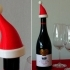 Santa Hat - Christmas decoration that fits onto the top of a bottle of Bubbly! image