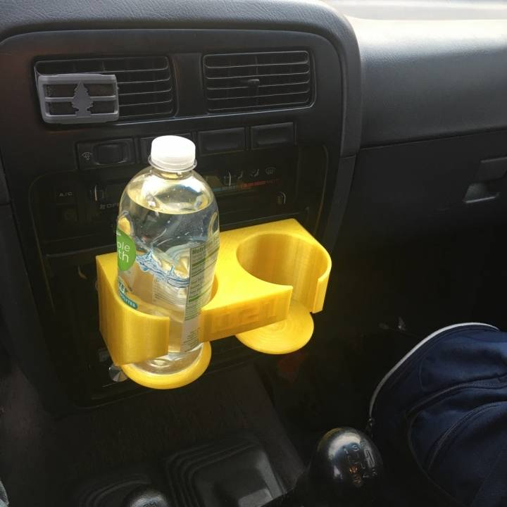 3D Printable 94 Nissan Hardbody Cup Holder/Coin Tray by Carter Schunk