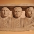 Funerary relief with the portraits of three brothers image