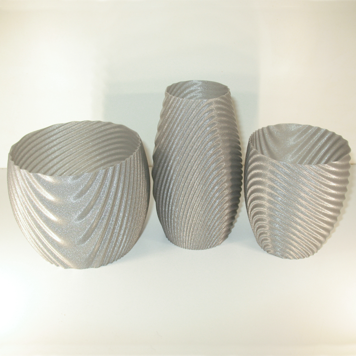 Wavy organic bowl, cups, vase and flower pot. image