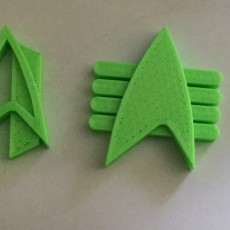 Picture of print of Starfleet Com Badges