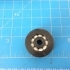"1.25"" OD, 0.25"" ID single race radial bearing using Airsoft pellets image"