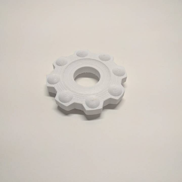 Gear with fake ball bearings