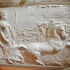 Relief sculpture of a chariot pulled by horses image