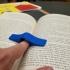 One hand book holder print image