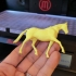 3D-printed toy horse figure (two halves) image