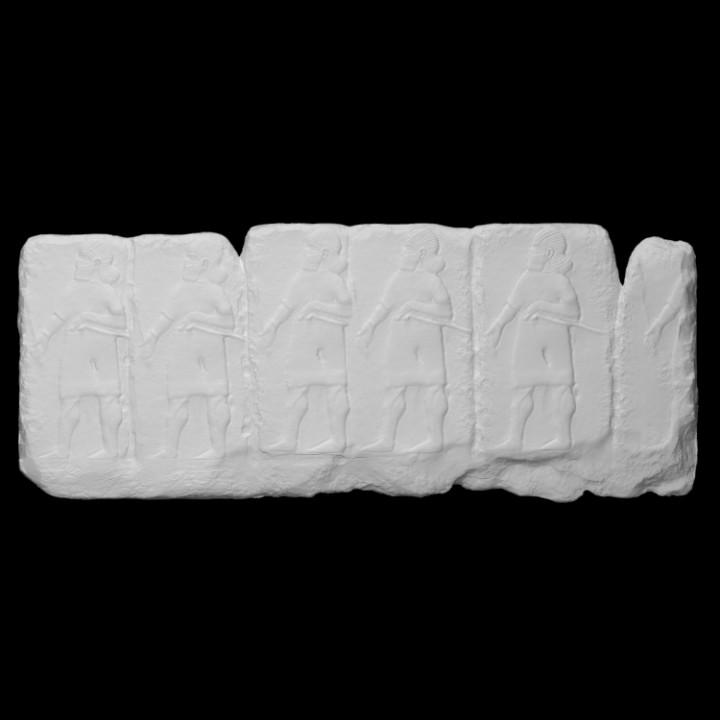 Hittite frieze fragment with mace-bearers
