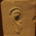 Stele with ear relief image