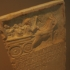 Inscribed stele with a relief depicting a cart image