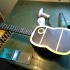 Acoustic guitar by Inayat Khan. image