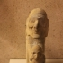 Limestone figure of an old man and boy and Stone figure of old man holding a serpent staff image