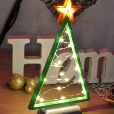Picture of print of lighted christmas tree with lighted star