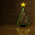 lighted christmas tree with lighted star image