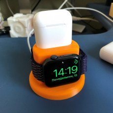 Picture of print of Apple Watch and Airpods charging dock