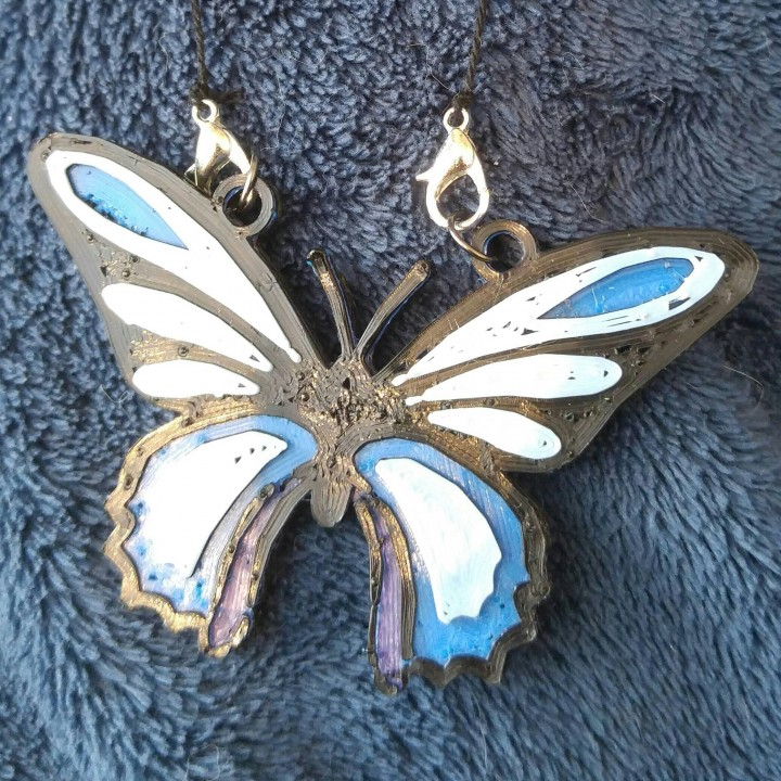 papillon bleu collier