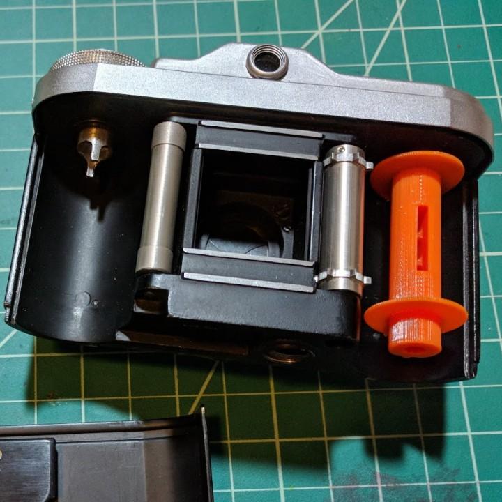 TAXONA 35mm film spool