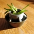 Small, simple flowerpot with drainage holes image