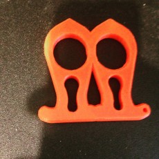 Picture of print of 2 finger self defense tool keychain (knuckle duster)