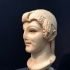 Archaistic head of a young woman image