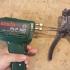 Tool to put elastics to hook image