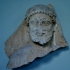 Fragmentary funerary stele of a wreathed man image