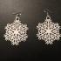 Snowflake earrings or christmas tree decorations image