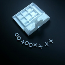 Picture of print of tick tack toe bord / phone charging stand