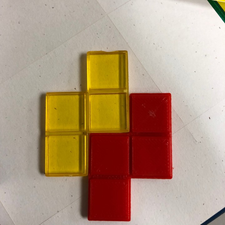 Blokus replacement piece (Yellow piece is the original)