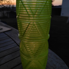 Picture of print of triangles on a curve vase