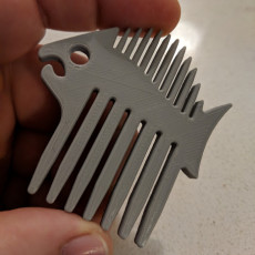 Fish-shaped comb for beard