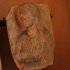 Part of a figurative funerary stele with torso of a woman image