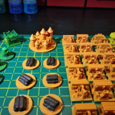 Picture of print of Root buiding and token miniatures
