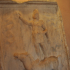 Carved stone slab of man standing on horse image