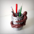 Immortal pen holder. image