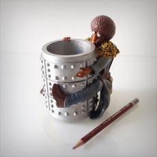 Afro pen holder.