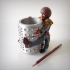 Afro pen holder. image