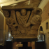Capital with depictions of humans and angels image