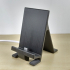 Smartphone stand with cable image