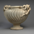 Marble strigilated vase with snake handles image